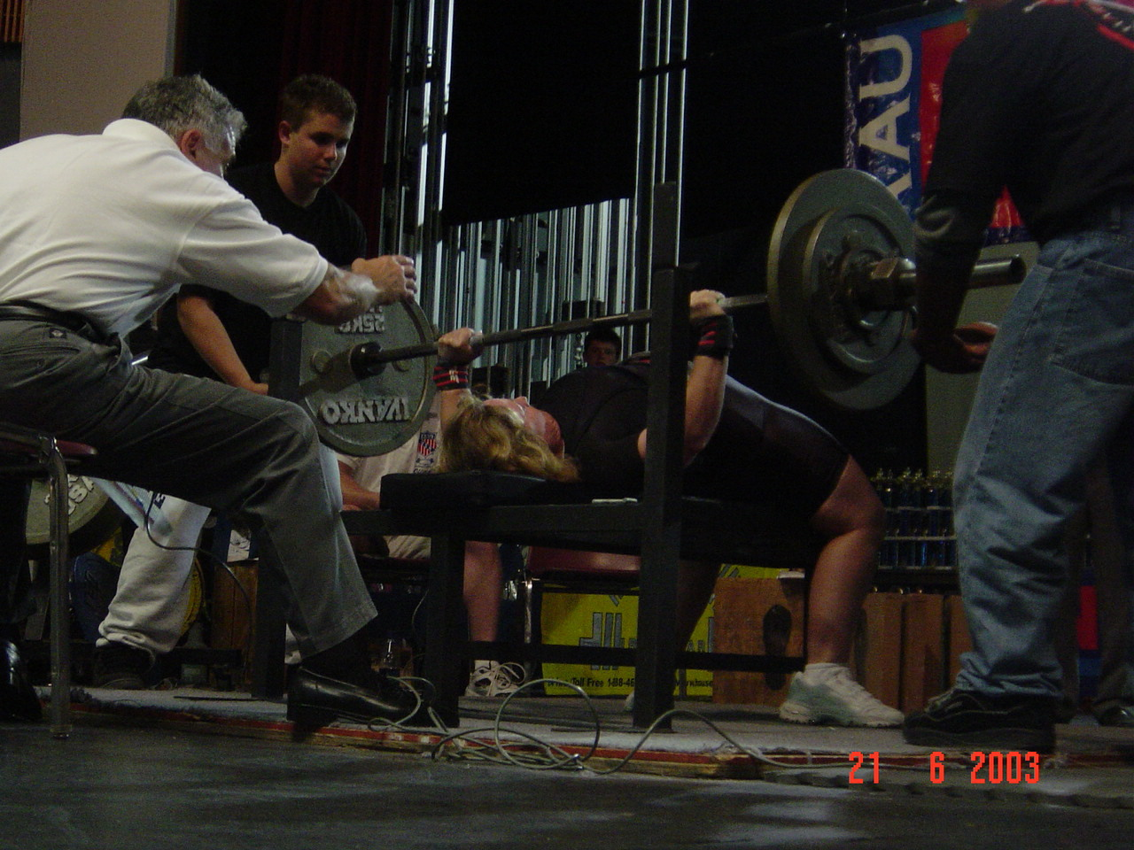 Gretchen Ashton benchpressing 218 pounds